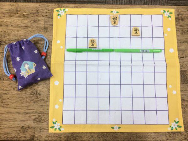 9×9の将棋盤では、手前から3段が自分の陣地。